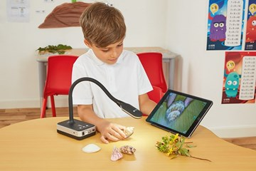 Child using a visualiser in the classroom